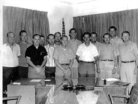 """CIA's A-12 """"drivers"""" and managers: (l. to r.) Layton, Sullivan, Vojvodich, Barrett, Weeks, Collins, Ray, BGen Ledford, Skliar, Perkins, Holbury, Kelly, and squadron commander Col. Slater."""